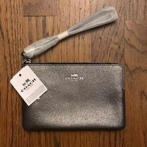 NEW with tags, metallic silver wristlet- Coach